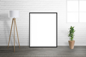 Poster frame mockup. Room interior with lamp and plant. Brick wall and window in background.