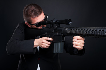 Male killer with sniper rifle