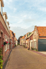 Typical small Dutch street with ancient houses