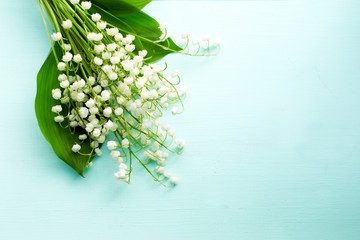 Bouquet of fresh white lilies of the valley in a wooden window still. Top view