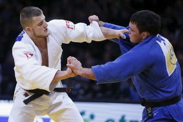 Aaron Wolf of Japan fights with Michael Korrel of the Netherlands in their men's under 100kg bronze medal fight at the Paris International Grand Slam judo tournament