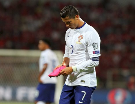 Portugal's Ronaldo holds his boot during their Euro 2016 qualifying soccer match against Albania at Elbasan arena stadium in Elbasan