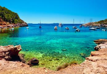 Sailboats at Cala Salada lagoon. Ibiza, Spain Wall mural