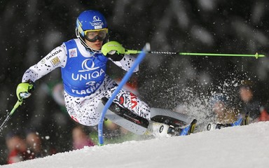 Velez Zuzulova of Slovakia clears a pole in the women's night slalom race of the Alpine Skiing World Cup in Flachau