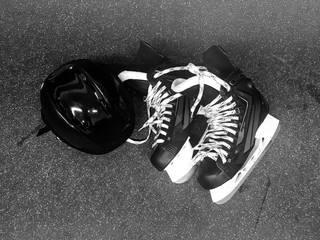 Hockey skates and helmet in black and white