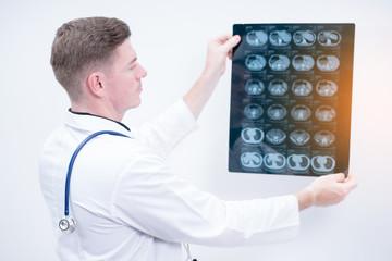 man doctor holding ct scan film