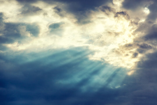Beautiful dramatic sunset cloudy sky with sun rays. Natural background and texture, abstract image