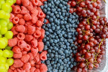 Fresh organic pomegranate seeds, blackberries, raspberries, blueberries and strawberries