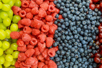 Raspberries, blackberries, blueberries a gray abstract background. Copyspace. Healthy food concept.