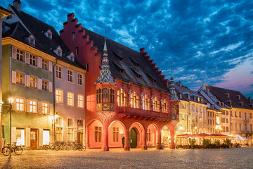 Historical building of Merchants Hall (Historisches Kaufhaus) built in 1520-21 and located on Munsterplatz squre in Freiburg, Baden-Wurttemberg, Germany
