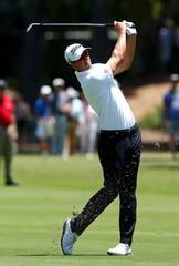 Australian golfer Adam Scott hits a shot during the first round of the Australian Open golf tournament at the Australian Golf Club in Sydney, Australia