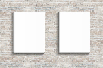 Two blank posters hanging on brick white wall of broken painted brick, mock up