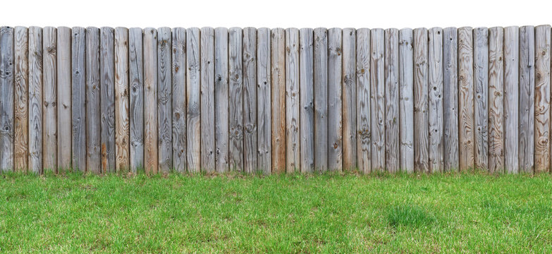 grassy hill with  a wooden fence