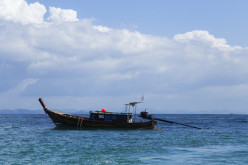 The turquoise sea with beautiful sky and clouds and the boat tour to Andaman Sea Thailand.