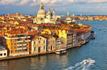 Venice. Top view of the Dorsoduro district, Cathedral of Santa Maria della Salute, embankment Zattere and Spirito Santo water bus stop in the rays of the setting sun