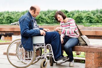 Man in wheelchair with girlfriend