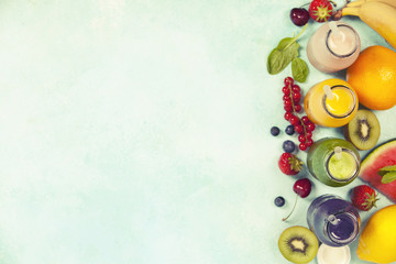 Fresh juices or smoothies with fruits and vegetables on blue background