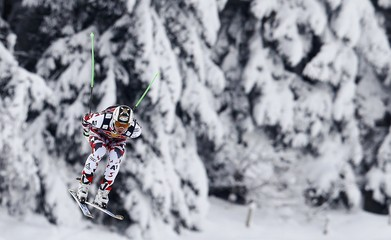 Reichelt of Austria skis during the men's Alpine Skiing World Cup downhill training on the Streif course in Kitzbuehel