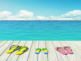 Flip-flops on wooden pier by the seashore. Family vacation