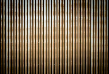 Old rusty corrugated metal wall of a barn building