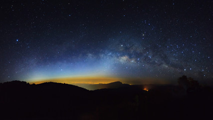 Panorama Milky Way Galaxy with light city at Doi inthanon Chiang mai, Thailand.Long exposure photograph.With grain