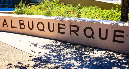 """A commemorate wall with the word """"Albuquerque"""" chiseled into it at the entrance to the Old Town part of this Southwest american city in New Mexico."""
