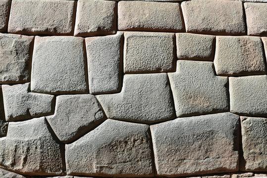 Pierres à joints vifs du mur inca rue Hatun Rumiyoc à Cusco au Pérou