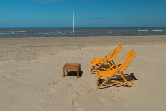 ORANGE DECKCHAIRS ON THE BEACH OF THE TOUQUET , PAS DE CALAIS, HAUTS DE FRANCE , FRANCE