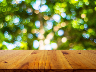 Empty of wood table top on blur of fresh green abstract background .For montage product display or design key visual layout