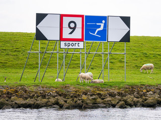 Sign on dike for speed limit and waterski on Spui river, Netherlands