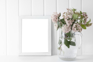 empty picture frame, decorated with Bouquet of pink natural flowers