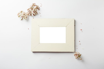 empty picture frame, decorated with small pink flowers