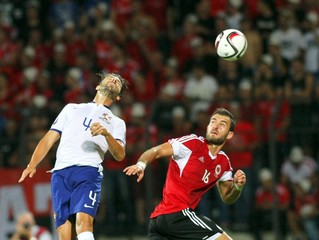 Albania's Sokol Cikalleshi fight for the ball with Portugal's Miguel Veloso during their Euro 2016 qualifying soccer match at Elbasan arena stadium in city of Elbasan, Albania,