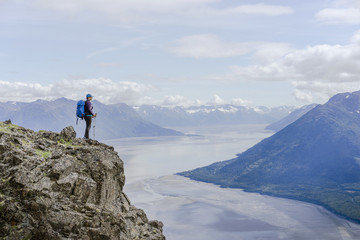 Female hiker at Hope Point in Chugach National Forest Alaska overlooking Turnagain Arm
