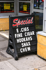 E. Cigs, Fine Cigars, Hookahs, Snax and chew tobacco sign in Minneapolis, MN, USA