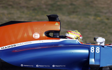 Manor Racing Formula One driver Haryanto of Indonesia speeds his car during the third testing session ahead the upcoming season at the Circuit Barcelona-Catalunya in Montmelo