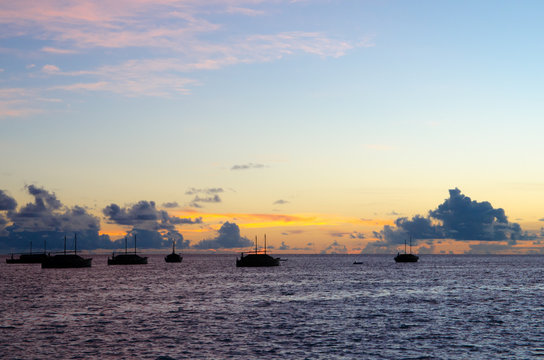 Evening scene of Indian Ocean with fisherman boats