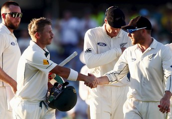 Australia's David Warner shakes hands with New Zealand captain Brendon McCullum at the end of the first day of the second cricket test match at the WACA ground in Perth, Western Australia