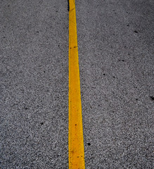Road and single yellow line.