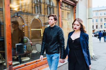 Cheerful couple walking through the city together