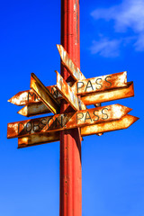 Rusting signs pointing to mountain passes in Wallace, Idaho USA