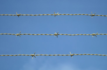 barbed wire on blue sky metal fence security barrier