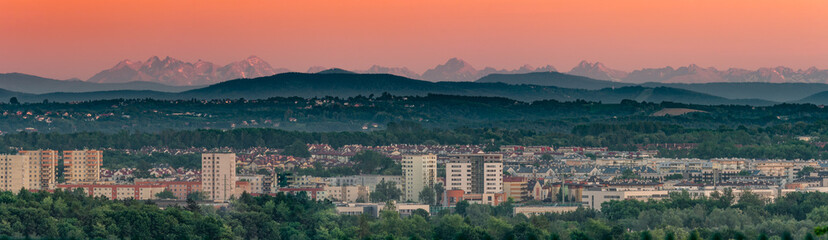 Krakow, Poland, panorama of southern city districts with Tatra mountains in the background