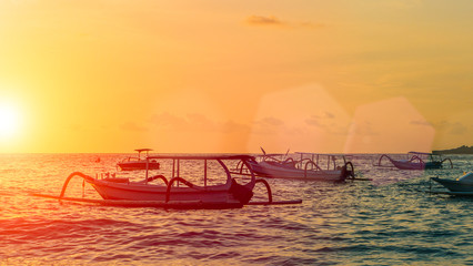 Sunset with boats in the foreground, Nusa Penida, Indonesia