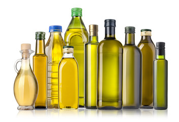 Olive oil bottles on white