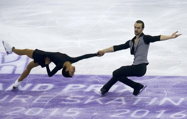 Ksenia Stolbova and Fedor Klimov of Russia  perform during the pairs short program at the ISU Grand Prix of Figure Skating final in Barcelona