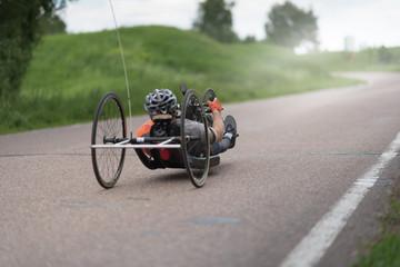 Aluminium Prints Bicycle man on recumbent bicycles on a asphalt road