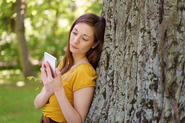 Serious young woman reading a text message