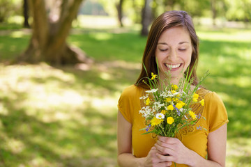 Young woman holding a simple posy of flowers