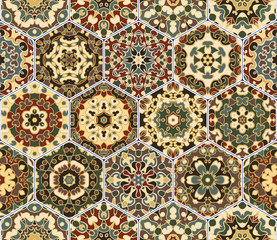 Bright seamless pattern of hexagonal tiles with vintage ornament. Colorful vector set of elements for design of wallpaper, fabric or wrapping paper.